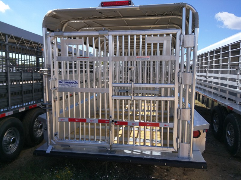 All trailers are available with a slide/swing tail gate that is very secure. The entire door will swing open against your loading chute or you can just slide the left door open and load straight from your catch gate.