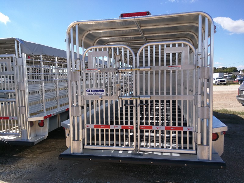 All aluminum trailers carry the strongest gates built. They are BULL gates. Notice the two cross latches with two down latches. Extra cross members are also built in.