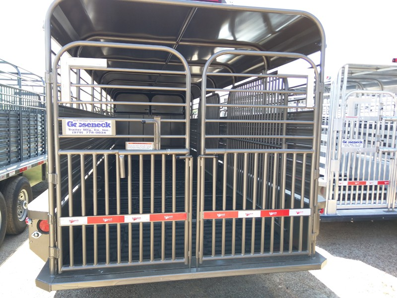 This is the standard tailgate on all Gooseneck steel trailers. It is tested and true. Offers two down latches and one cross latch for secure transport. The gates will swing in or out and operate independent of each other.