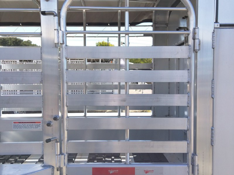 A Full escape door on a aluminum trailer. A lot of people would like to haul the horse at the front or be able to put the generator, etc in the trailer if going to a stock show. We can fix you up with a full escape door.